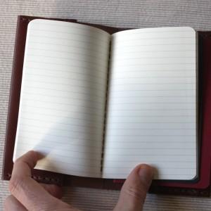 El cuaderno con líneas (para las notas)