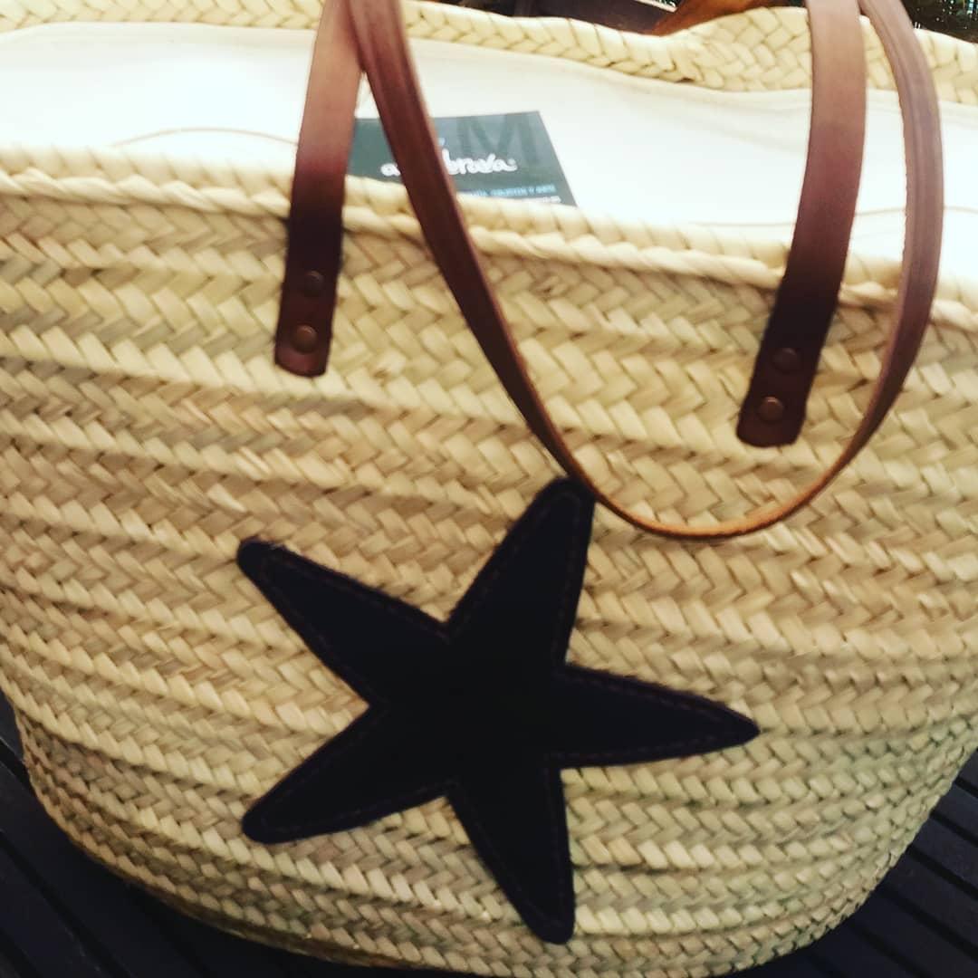 Bolso de playa con cierre de cremallera y una estrella de piel cosida